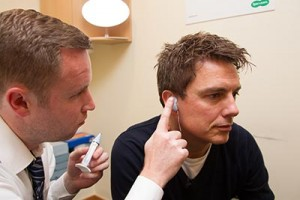John getting the gel ear moulds inserted
